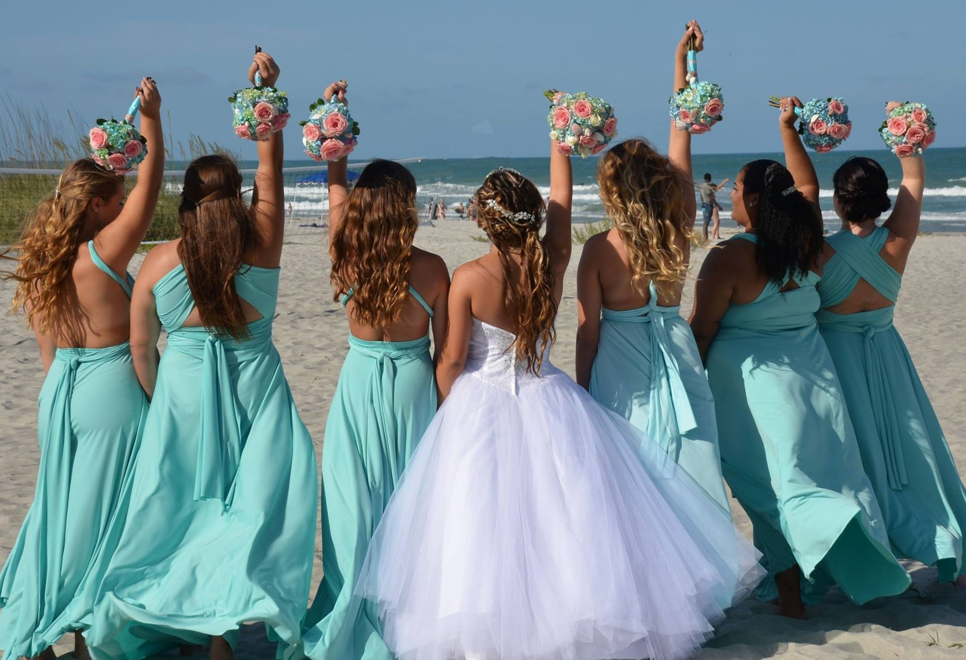 Photo of a bride and her wedding party