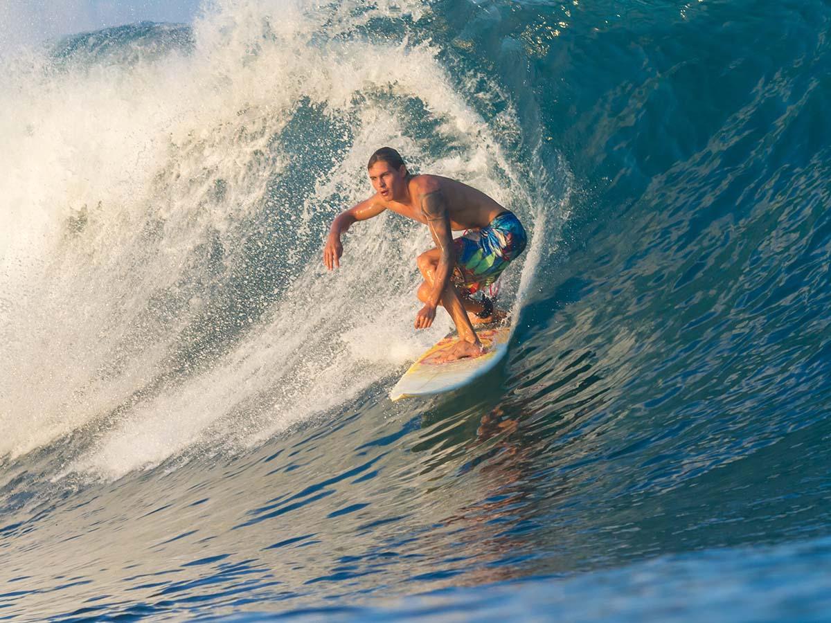 A man surfing a wave.